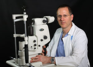 Prof. Eytan Blumenthal and one of our Laser devices
